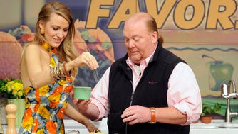 Mario Batali, seen here with actress Blake Lively in a 2015 episode of 'The Chew,' has been fired from ABC's food-focused talk show.