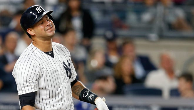 New York Yankees' Gary Sanchez reacts striking out during the fifth inning of a baseball game against the Los Angeles Dodgers in New York, Monday, Sept. 12, 2016.