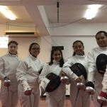 Students learn the epee
