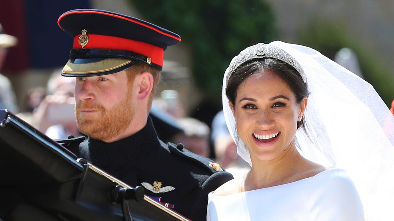 Prince Harry and Meghan Markle gazed into each other's eyes at the altar in St. George's Chapel in Windsor as their wedding got underway on Saturday, as a soprano sang to celebrate the trans-Atlantic union. (May 19)