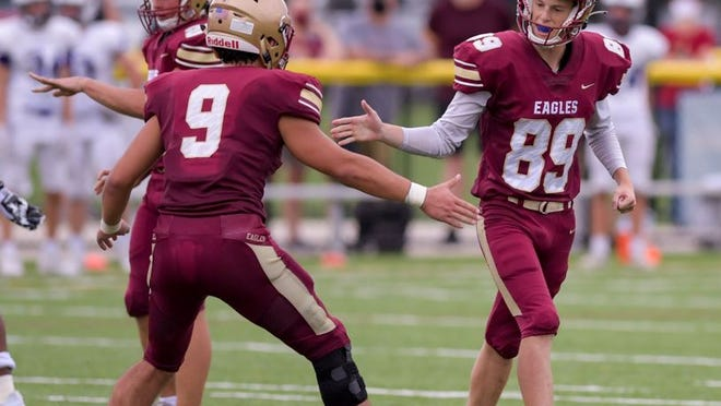 Watterson's Danny Siegel (left) congratulates Carson Blank on a successful field goal against DeSales on Aug. 28.
