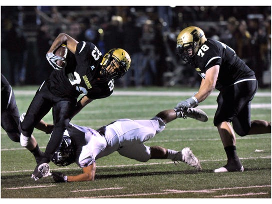 Abilene High School running back Jordan booker is knocked