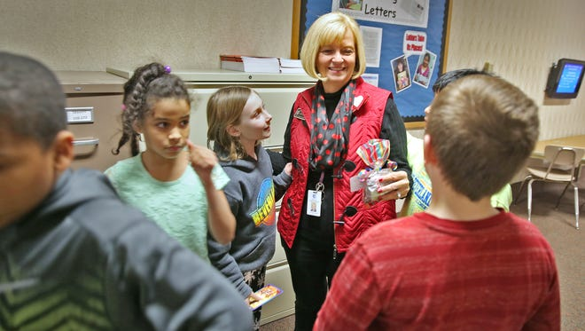"Connie Thomas visited with students as she walked through the halls at Amy Beverland Elementary on Friday, Feb. 12, 2016. Thomas, who refers to herself as the ""guest principal,"" is filling in for longtime Principal Susan Jordan, who was killed in an accident at the school."
