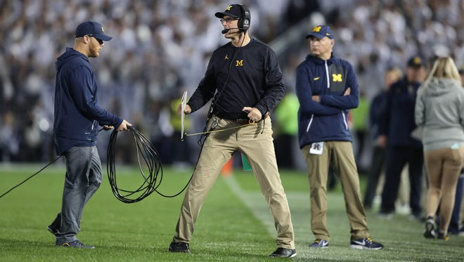 Michigan coach Jim Harbaugh says his team is tough enough to learn from Saturday's 42-13 loss to Penn State.