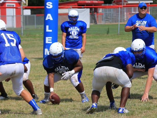 Salem players work on offensive snaps during practice