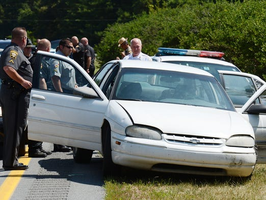 Police from multipule agency's at the scene of were a woman was arrested Monday after police say she led several Delaware and Maryland agencies on a high-speed chase across state lines after she robbed a bank in Laurel earlier this morning.