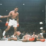 World heavyweight champion Muhammad Ali is held back by referee Joe Walcott after Ali knocked out challenger Sonny Liston in 1 minute, 42 seconds of the first round of the scheduled 15 round championship bout in Lewiston, Maine, May 25, 1965.