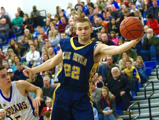 Greencastle-Antrim's Casey Hoover (22) reaches to keep