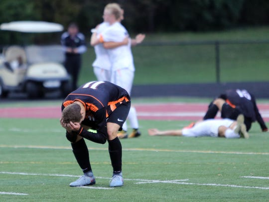 Anderson's Jack Voegele reacts as time runs out in