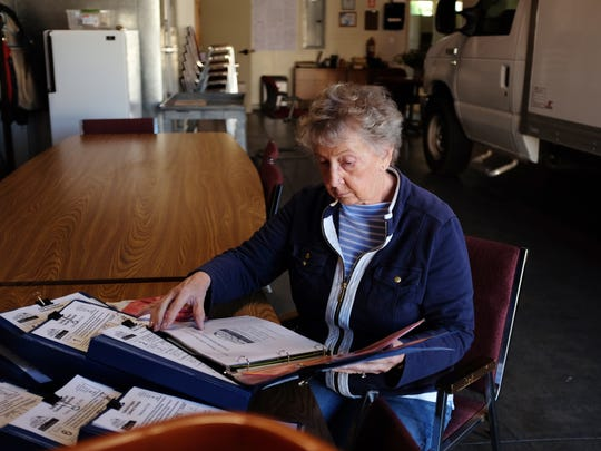 Volunteer Rosalie Tull goes through order books at Meals on Wheels of the Salinas Valley in Salinas.