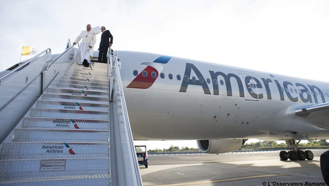 In this photo taken Thursday, Sept. 24, 2015, Pope Francis arrives at the JFK airport in New York from Washington, where he addressed a joint meeting of Congress on Capitol Hill. (L'Osservatore Romano/Pool Photo via AP)
