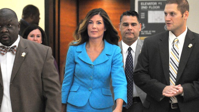 Pennsylvania Attorney General Kathleen Kane enters the Montgomery County courtroom on Thursday, August 11, 2016 to continue her trial in Norristown, Pa. Kane, a first-term Democrat, was accused of leaking secret grand jury documents to the press and lying about it under oath.