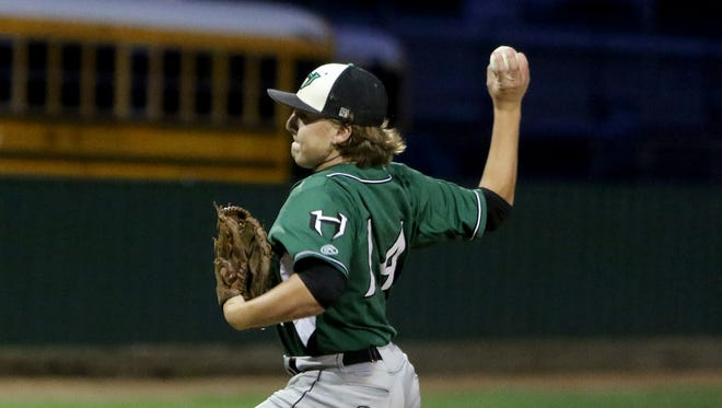 Iowa Park's Derek Hostas pitches against Burkburnett Friday, April 21, 2017, in Burkburnett. The Hawks defeated the Bulldogs 14-1 as Hostas gave up just three hits and struck out nine.