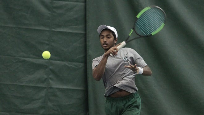 Shashank Reddy of Mason returns a volley at the Coaches Classic in the Camargo Racquet Club April 29.