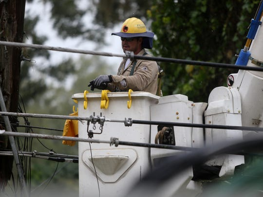 COT lineman Jonathan Wiley works to restore power after