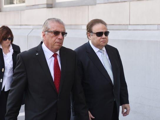 Menendez's co-defendant, Salomon Melgen, right, went