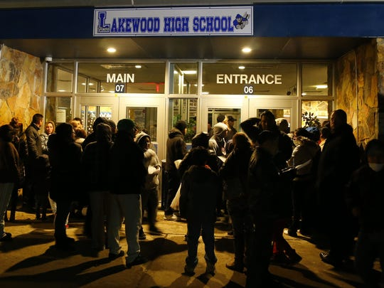 Residents stand outside waiting to get into high school for  Lakewood Board of Education meeting. Lakewood,NJ. Thursday, February 11, 2016. Noah K. Murray-Special for the Asbury Park Press  ASB 0211 busing meeting