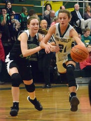 Menard's Aly Jo Warren (21) drives down the lane against