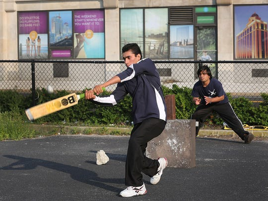 Humqyun Khan bats during a cricket match in a vacant lot next to Boardwalk Hall in Atlantic City.