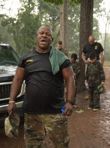 Drill Sergeant Steven Sullivan says a prayer after finishing up bootcamp in the rain outside of Quest Leadership Academy in Greenville on Thursday, May 10, 2018. Sullivan started the bootcamp in 2011 to try and help kids from different backgrounds combat drugs, teach respect, and promote a healthy lifestyle.