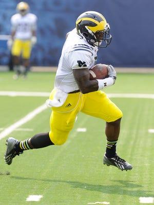 Michigan freshman cornerback Jabrill Peppers returns a punt during practice Aug. 8, 2014.