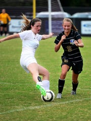 Sacred Heart's Anna Easley attempts to gain posession of the ball before Westview's Hayley Shumake on Tuesday.
