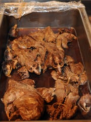 Posed at the center of the Isherwood family table was the supreme artifact: muskrat - about six of them roasted, sauced, heads attached.