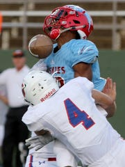 Hirschi's Javen Banks is hit as he attempts to make