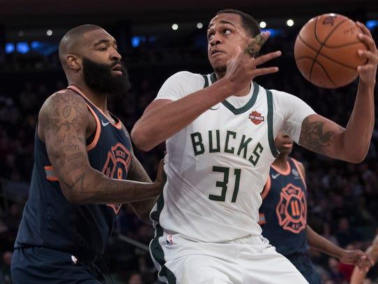 New York Knicks center Kyle O'Quinn (9) guards Milwaukee