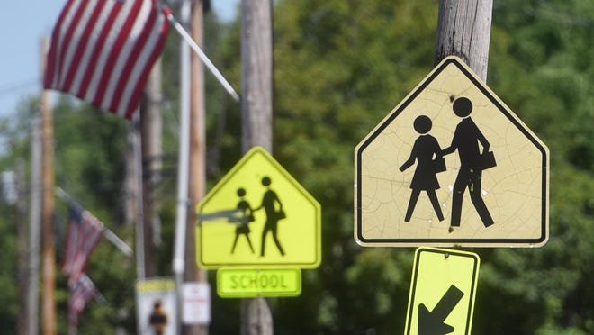 A school logo sign is near the High Street crossing onto Memorial Drive in Somersworth. As the traditional school opening time gets closer, officials explaining the reopening plans they are expecting to implement during the coronavirus pandemic.