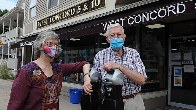 Debra Stark, owner of Debra's Natural Gourmet,  and Maynard Forbes, owner of the West Concord 5 & 10, in front of their stores on Commonwealth Ave., July 15, 2020.  Stark has bought Forbe's building next door.  The Concord 5 & 10 will close December 31, 2020 and Debra's will expand.