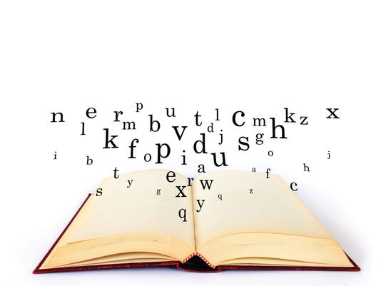 Research, word on the book with letters flying