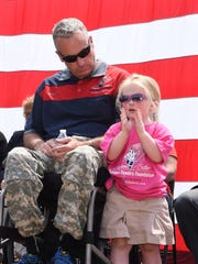 Former Army Staff Sgt. Stephen Valyou sits with his