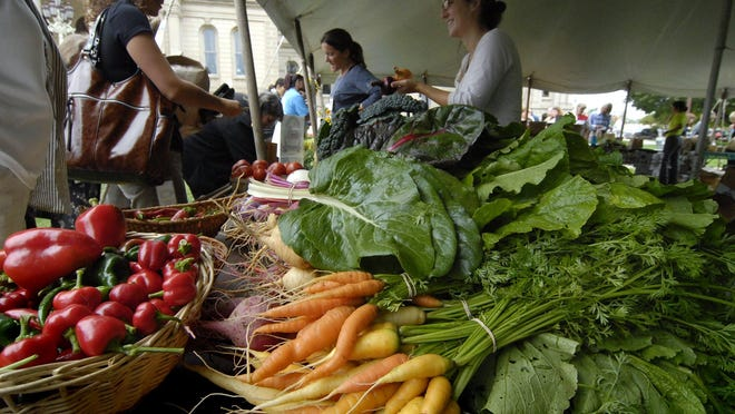 --Fresh carrots, peppers and other vegetables at the MSU Student Organic Farm booth at the statewide Farmer's Market on the lawn of the State Capitol Building in Lansing Thursday. (photo by rod sanford)