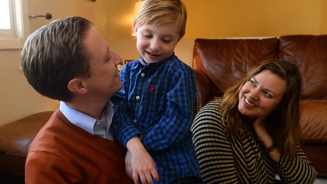Jack Bennion, 6, with his parents Jon and Jessi at their home in Clancy in October.