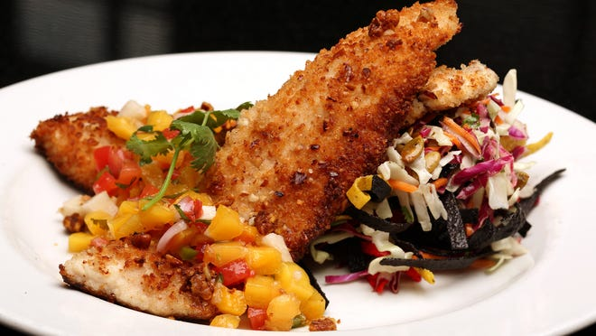 Pecan-crusted trout is an entree option at Firebirds Wood-Fired Grill.