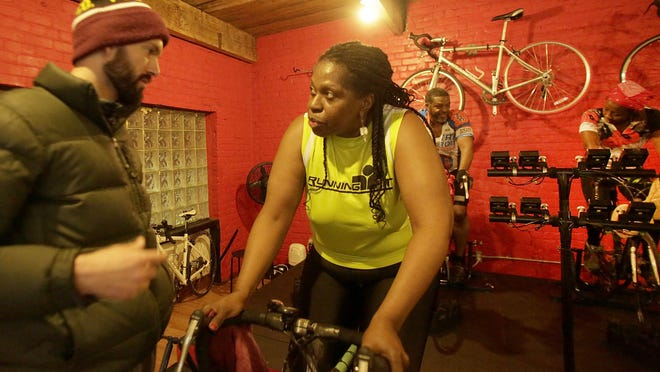 Landall Proctor, cycling coach and owner of the Detroit Endurance Lab, works with Cassandra Spratling as she trains for her bike ride from Selma to Montgomery.