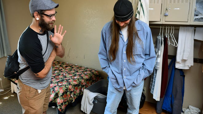 Daniel Nordlund (left) and Jeff King talk about living with homelessness Wednesday at the Salvation Army's Emergency Center in St. Cloud where they both currently live.