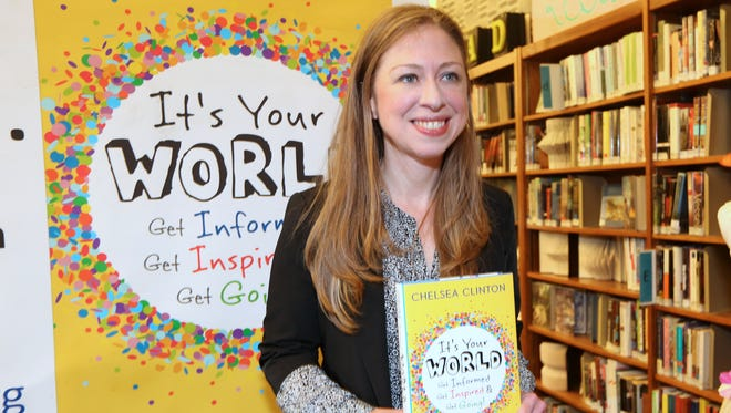 """Chelsea Clinton signs copies of her book, """"It's Your World"""" at the Chappaqua Library Sept. 30, 2015."""