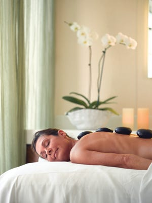 A hot stone massage is among the options at the spa on Oceania ships.