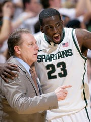 In this Feb. 16, 2012, file photo, Michigan State's Draymond Green (23) talks with coach Tom Izzo during the first half against Wisconsin in East Lansing.