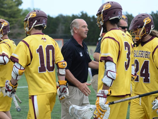 Salisbury's Head Coach Jim Berkman congratulates his team after the NCAA Division III Semifinals win against Denison University 12-11 at Seagull Stadium on Sunday, May 21, 2017.