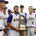 Waukee players hold their state participant trophy after falling to Cedar Rapids Prairie Friday, July 29, 2016, during their class 4A semifinal game at the state baseball tournament at Principal Park in Des Moines