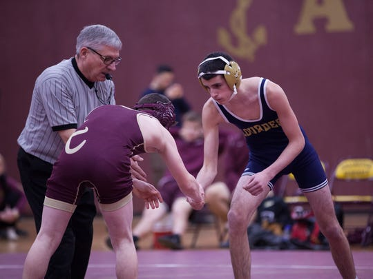 Our Lady of Lourdes High School's Anthony Silano, right,