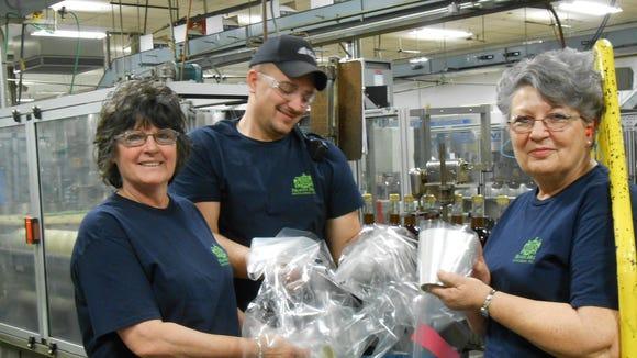 Heaven Hill Distilleries employees recycling.