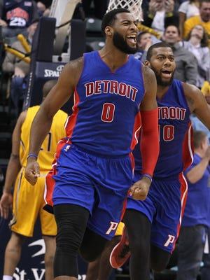 Detroit Pistons center Andre Drummond (0) reacts to making the game winning shot with 0.3 of a second left in the game and congratulated by forward Greg Monroe (10) against the Indiana Pacers at Bankers Life Fieldhouse on Friday. Detroit defeats Indiana 98-96.