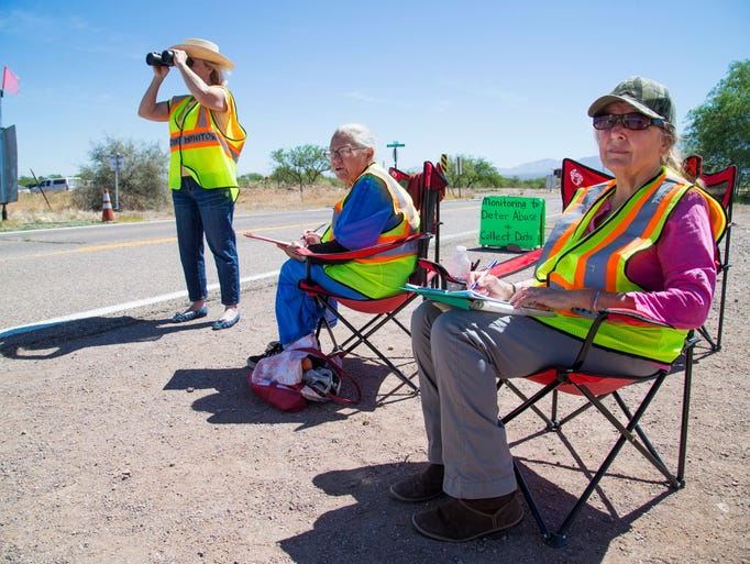 Coey Stern (from left), Patty Miller and Bobbie Chitwood watch a Border Patrol checkpoint on Arivaca Road, about 20 miles northeast of Arivaca.