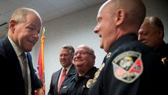 TBI Director David Rausch shakes hands with Dyersburg