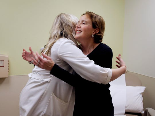 Sara Everts, a recent liver transplant recipient, hugs  Shannon Sova (pre-liver transplant coordinator)   and a member  of her transplant team during her checkup at The Center for Advanced Care at Froedtert Hospital, Wednesday, October 25, 2017.   For story by from Green Bay  Press Gazette journalist Nate Phelps who is writing series of articles on the unsung hero's of organ transplant. Milwaukee Journal Sentinel photo by Rick Wood/ rgwood@gannett.com