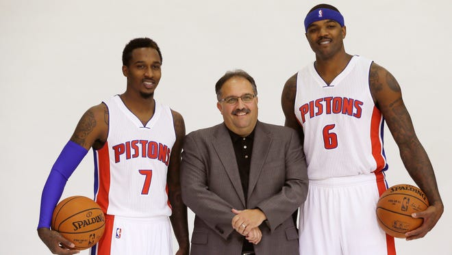 Detroit Pistons coach Stan Van Gundy, center, stands with guard Brandon Jennings, left, and forward Josh Smith during media day Sept. 29, 2014.